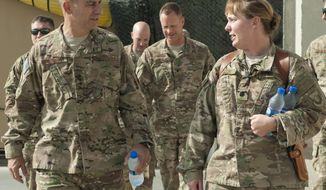 "In this image provided by the U.S. Air Force, Lt. Gen. Jeffrey Harrigian, who was then-U.S. Air Forces Central Command commander, walks with Lt. Col. Joy Boston, 455th Expeditionary Operations Support Squadron commander at Bagram Airfield, Afghanistan, on Oct. 5, 2016. U.S. military phone calls with Russia have increased as the two countries work to avoid aircraft mishaps in the increasingly crowded skies over Syria, a senior American Air Force commander said May 24, 2017. Harrigian, who is in charge of U.S. air operations in the Middle East, also told Pentagon reporters that the U.S. has been setting up temporary ""deconfliction"" zones around Syria. (Korey Fratini/U.S. Air Force via AP)"