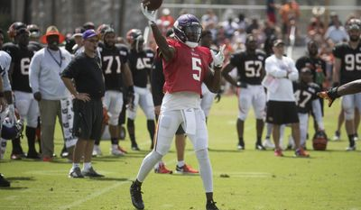 FILE - In this Aug. 10, 2016, file photo, Minnesota Vikings quarterback Teddy Bridgewater (5) throws during a joint NFL football practice with the Cincinnati Bengals, in Cincinnati. Bridgewater has reached the point in rehabilitation where he's able to drop back to pass on his surgically repaired left knee. Just when the 24-year-old quarterback might return to live action with the Vikings remains largely unknown.Vikings general manager Rick Spielman said Wednesday, May 24, 2017, that Bridgewater has not been cleared for full practice. (AP Photo/John Minchillo, File)
