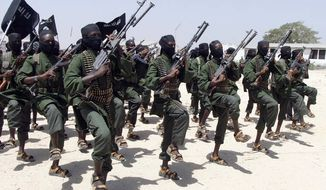 Hundreds of newly trained al-Shabab fighters performed military exercises, in Feb. 2011, in the Lafofe area some 11 miles south of Mogadishu, in Somalia. The U.S. military said today that a service member was killed in Somalia during an operation against the extremist group al-Shabab. (Associated Press)