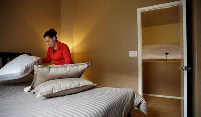 Jennifer Mesa cleans up a bedroom in the home of Randy Tussing, an Airbnb host in Las Vegas. More than 340,000 people passed on Nevada's hotel rooms last year and opted instead to book a place to stay using the short-term rental service. (Associated Press)