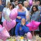 Olivia Campbell's mother, Charlotte Campbell, and stepfather Paul Hodgson, pay tribute to the 15-year-old girl and other victims of the explosion outside Manchester Arena on Monday. The U.K. stopped sharing information with the U.S. about the investigation of the Islamic State-linked bombing after a leak to the media. (Associated Press)