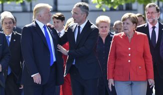 German Chancellor Angela Merkel, after hosting former President Barack Obama in Berlin, met with President Trump and NATO Secretary General Jens Stoltenberg on Thursday. (Associated Press)