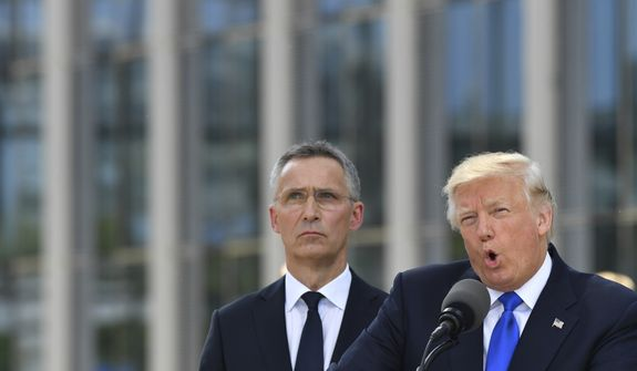 U.S. President Donald Trump, right, speaks as NATO Secretary General Jens Stoltenberg looks on during ceremony at NATO headquarters at the NATO summit in Brussels on Thursday, May 25, 2017. US President Donald Trump and other NATO heads of state and government on Thursday will inaugurate the new headquarters as well as participating in an official working dinner. (AP Photo/Geert Vanden Wijngaert)