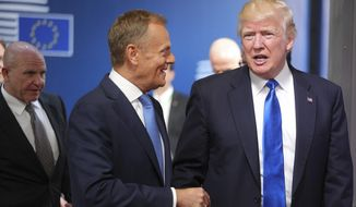 U.S. President Donald Trump is greeted by European Council President Donald Tusk as he arrives at the Europa building in Brussels on Thursday, May 25, 2017. Trump arrived in Belgium Wednesday evening and will attend a NATO summit as well as meet EU and Belgian officials. (AP Photo/Olivier Matthys)