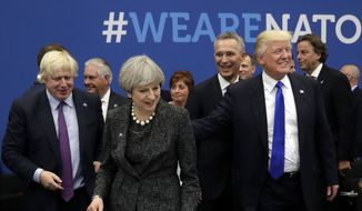 Britain's Foreign Secretary Boris Johnson, right, greets British Prime Minister Theresa May, center, and U.S. President Donald Trump during working dinner meeting at the NATO headquarters during a NATO summit of heads of state and government in Brussels on Thursday, May 25, 2017. US President Donald Trump inaugurated the new headquarters during a ceremony on Thursday with other heads of state and government. (AP Photo/Matt Dunham, Pool)