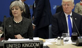 U.S. President Donald Trump, right, sits next to British Prime Minister Theresa May during in a working dinner meeting at the NATO headquarters during a NATO summit of heads of state and government in Brussels on Thursday, May 25, 2017. US President Donald Trump inaugurated the new headquarters during a ceremony on Thursday with other heads of state and government. (AP Photo/Matt Dunham, Pool)
