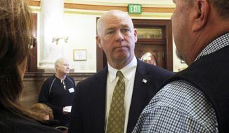 In this March 6, 2017, file photo, technology entrepreneur Greg Gianforte speaks to Republican delegates before a candidate forum in Helena, Mont. Gianforte, charged with misdemeanor assault for shoving a reporter to the ground on the eve of a special election, kept a low profile Thursday, May 25, even as supporters prepared a hotel ballroom for a possible victory party. (AP Photo/Matt Volz, File)