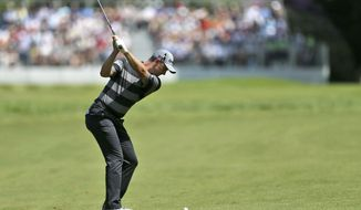 England's Justin Rose plays an approach shot  during day one of BMW PGA Championship at Wentworth Golf Club,  near Virginia Water England Thursday May 25, 2017. (Steven Paston/PA via AP)