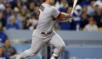 St. Louis Cardinals' Jedd Gyorko singles to left field, two runs score on an error by Los Angeles Dodgers left fielder Cody Bellinger during the fifth inning of a baseball game in Los Angeles, Wednesday, May 24, 2017. (AP Photo/Alex Gallardo)