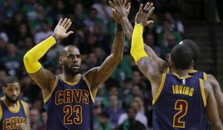 Cleveland Cavaliers forward LeBron James (23) trades high-five's with Cleveland Cavaliers guard Kyrie Irving (2) during the first half of Game 5 of the NBA basketball Eastern Conference finals against the Boston Celtics, on Thursday, May 25, 2017, in Boston. (AP Photo/Elise Amendola)