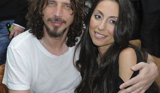 """FILE - In this April 27, 2012, file photo, Chris Cornell, at left, and his wife, Vicky Karayiannis attend the celebration of """"Commando: The Autobiography of Johnny Ramone,"""" in Los Angeles. Vicky Cornell penned a  letter addressed to the late Soundgarden front man published on May 24, 2017, days after he took his own life.(AP Photo/Katy Winn, File)"""