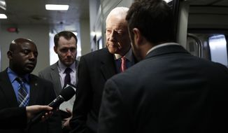 Sen. Orrin Hatch, R-Utah talk to a reporter as he steps onto the Capitol Subway on Capitol Hill in Washington, Wednesday, May 24, 2017. (AP Photo/Carolyn Kaster)