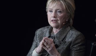 "In this April 6, 2017, file photo, former Secretary of State Hillary Clinton speaks in New York. Half a year after her stunning loss to Donald Trump in November 2016, a loss that left her devastated and heartbroken, those close to her say, she has professed herself ""ready to come out of the woods."" (AP Photo/Mary Altaffer, File)"