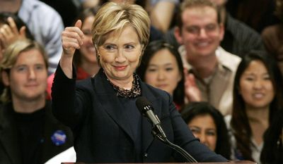 FILE - In this Nov. 1, 2007 file photo, Democratic Presidential hopeful Sen. Hillary Rodham Clinton, D-N.Y., speaks at Wellesley College in Wellesley, Mass. Clinton also spoke at her graduation ceremony at Wellesley in 1969 and 48 years later, she returns Friday, May 26, 2017 to offer another speech. (AP Photo/Elise Amendola, File)
