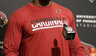 FILE - In this Oct. 6, 2016, file photo, Arizona Cardinals running back David Johnson speaks at a news conference after an NFL football game against the San Francisco 49ers, in Santa Clara, Calif. Maybe it's his cheerful smile or his squeeky clean character. Or his devastatingly athletic performances on the field. All these things have helped Arizona Cardinals running back David Johnson top the latest ``Rising 50'' list of players likely to break out and rank among next season's best sellers of licensed merachandise.  (AP Photo/Marcio Jose Sanchez, File)