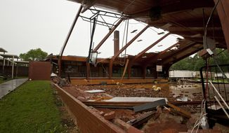 Debris rests on the floor after the roof was blown off of the gymnasium at Courtney Elementary School in Courtney, N.C. Wednesday, May 24, 2017. (Walt Unks/The Winston-Salem Journal via AP)