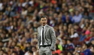 FC Barcelona's coach Luis Enrique shouts instructions during the Spanish La Liga soccer match between FC Barcelona and Eibar at the Camp Nou stadium in Barcelona, Spain, Sunday, May 21, 2017. (AP Photo/Manu Fernandez)