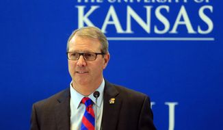 Dr. Douglas Girod gives a short speech after being named 18th chancellor of the University of Kansas during a Board of Regents meeting in Lawrence, Kan., Thursday, May 25, 2017. (AP Photo/Orlin Wagner)
