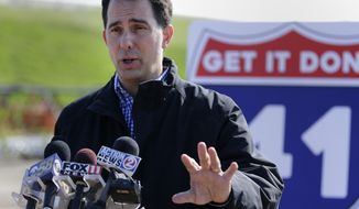 Wisconsin Gov. Scott Walker speaks about his proposed transportation budget Thursday, May 25, 2017, at the Wis 441 Tri-County Project construction site in the Village of Fox Crossing, Wis.  (Danny Damiani/USA TODAY NETWORK-Wisconsin/The Post-Crescent via AP)