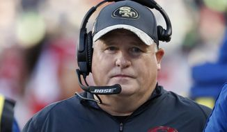 San Francisco 49ers head coach Chip Kelly stands on the sideline during the second half of an NFL football game against the Seattle Seahawks in Santa Clara, Calif., in this Jan. 1, 2017, file photo. Former Oregon coach Chip Kelly is joining ESPN as a studio analyst next season. ESPN announced Friday, May 26, 2017, it has signed Kelly to a multiyear deal. (AP Photo/Tony Avelar, File)