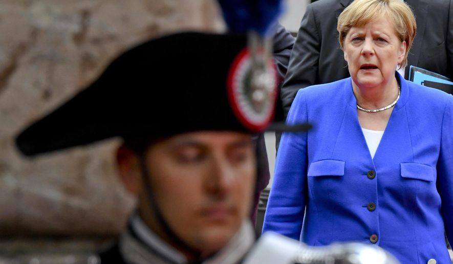 German Chancellor Angela Merkel arrives at the San Domenico Palace Hotel, the venue of the annual G7 summit, in the Sicilian town of Taormina, Italy, Friday, May 26, 2017.  Leaders of the G7 meet Friday and Saturday, including newcomers Emmanuel Macron of France and Theresa May of Britain in an effort to forge a new dynamic after a year of global political turmoil amid a rise in nationalism. (Ciro Fusco/ANSA via AP)