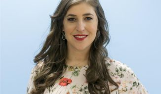 "In this May. 23, 2017, photo, actress and author Mayim Bialik poses for a photo in Los Angeles. Bialik plays smart on TV's ""The Big Bang Theory"" and is smart in real life, with a Ph.D. in neuroscience as evidence. She joins her intelligence with experience in ""Girling Up: How to be Strong, Smart and Spectacular,"" a wide-ranging handbook on navigating the emotional and physical hurdles of growing up.  (AP Photo/Damian Dovarganes)"