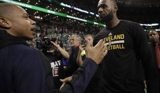 Boston Celtics guard Isaiah Thomas, left, and Cleveland Cavaliers forward LeBron James speak after Game 5 of the NBA basketball Eastern Conference finals, on Thursday, May 25, 2017, in Boston. The Cavaliers won 135-102. (AP Photo/Elise Amendola)