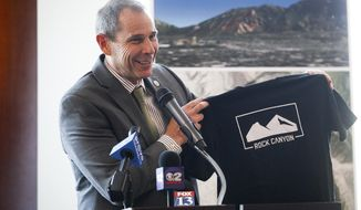 FILE - In this April 29, 2014, file photo, Provo Mayor John Curtis speaks during a news conference in Provo, Utah. State Sen. Deidre Henderson and Curtis lead a packed field of candidates squaring off for the open congressional seat soon-to-be vacated by U.S. Rep. Jason Chaffetz. A total of 10 Republicans and three Democrats had filed to run by Friday, May 26, 2017, eight days after Chaffetz announced he would resign from Congress. (Spenser Heaps/The Daily Herald via AP, File)