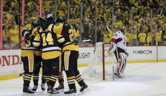 CORRECTS TO SECOND PERIOD - Pittsburgh Penguins left wing Chris Kunitz (14) celebrates with teammates after scoring a goal against the Ottawa Senators during the second period of Game 7 in the NHL hockey Stanley Cup Eastern Conference finals, Thursday, May 25, 2017, in Pittsburgh. (AP Photo/Keith Srakocic)