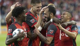 Toronto FC's Victor Vazquez, center right, is mobbed by teammates after scoring his second goal and his team's third against the Columbus Crew during second-half MLS soccer game action in Toronto, Friday, May 26, 2017. (Chris Young/The Canadian Press via AP)