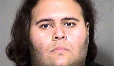 This Thursday, May 25, 2017, photo provided by the Maricopa County Sheriff's Office shows Matthew Sterling in Phoenix, Ariz. Sterling was taken into custody Thursday after a brief struggle with police at the Phoenix Convention Center. Police are adding extra security at the Phoenix Comicon following the arrest of Sterling, who was armed with guns and ammunition and who allegedly posted online threats against police officers.  (Maricopa County Sheriff's Office via AP)