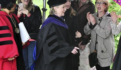 Supporters cheer former Secretary of State Hillary Clinton as she makes her way to deliver the commencement address at Wellesley College, Friday, May 26, 2017 in Wellesley, Mass. Clinton graduated from the school in 1969. (AP Photo/Josh Reynolds)