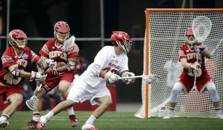 Maryland's Connor Kelly moves past the defense of Denver's Christian Thomas (43) and Danny Logan (19) to score against goalkeeper Alex Ready (16) during the second half of an NCAA college Division 1 lacrosse semifinal, Saturday, May 27, 2017, in Foxborough, Mass. Maryland won 9-8 and will advance to face Ohio State in the championship final. (AP Photo/Elise Amendola)