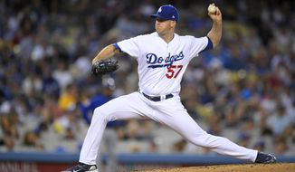 Los Angeles Dodgers starting pitcher Alex Wood throws to the plate during the third inning of a baseball game against the Chicago Cubs, Friday, May 26, 2017, in Los Angeles. (AP Photo/Mark J. Terrill)
