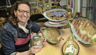 In this April 25, 2017 photo, Lisa Naples, an accomplished ceramicist who makes whimsical and colorful vessels and sculptures, poses in her Doylestown, Pa., studio. (Art Gentile/The Intelligencer via AP)