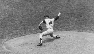 FILE - In this June 21, 1964, file photo, Jim Bunning of the Philadelphia Phillies pitches a perfect game against the New York Mets at Shea Stadium in New York. Hall of Fame pitcher Bunning, who went on to serve in Congress, has died. Bunning's death Friday, May 26, 2017, was confirmed by Jon Deuser, who served as chief of staff when Bunning was in the Senate. (AP Photo/File)