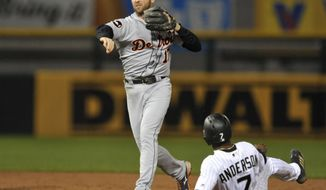 Detroit Tigers second baseman Andrew Romine (17) throws to first base after forcing out Chicago White Sox's Tim Anderson (7) at second base during the second inning of a baseball game Friday, May 26, 2017, in Chicago. (AP Photo/Paul Beaty)