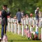 An unidentified member of the U.S. Army salutes at a grave site on Memorial Day at Arlington National Cemetery in Arlington, Va., Monday, May 28, 2012. (Rod Lamkey Jr/The Washington Times)