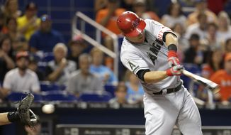 Los Angeles Angels' Mike Trout strikes out swinging during the first inning of an interleague baseball game against the Miami Marlins, Sunday, May 28, 2017, in Miami. (AP Photo/Lynne Sladky)