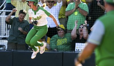 Oregon's Alexis Mack celebrates a late rally to defeat Kentucky in the NCAA college softball super regionals on Saturday, May 27, 2017, in Eugene, Ore.  (Collin Andrew/The Register-Guard via AP)