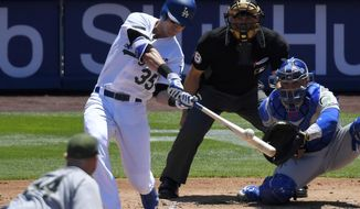 Los Angeles Dodgers' Cody Bellinger, second from left, hits a three-run home run as Chicago Cubs starting pitcher Jon Lester, left, watches along with catcher Willson Contreras, right, and home plate umpire Dan Iassogna during the second inning of a baseball game, Sunday, May 28, 2017, in Los Angeles. (AP Photo/Mark J. Terrill)