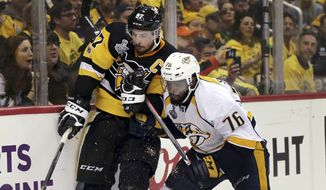 Nashville Predators' P.K. Subban, right, ties up Pittsburgh Penguins' Sidney Crosby during the second period in Game 1 of the NHL hockey Stanley Cup Finals on Monday, May 29, 2017, in Pittsburgh. (AP Photo/Keith Srakocic)