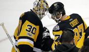 Pittsburgh Penguins' captain Sidney Crosby, right, speaks to Pittsburgh Penguins' goalie Matt Murray after their 5-3 win over the Nashville Predators in Game 1 of the NHL hockey Stanley Cup Finals, Monday, May 29, 2017, in Pittsburgh. (AP Photo/Gene J. Puskar)