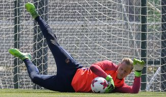 FC Barcelona's goalkeeper Marc-Andre ter Stegen saves a ball during a training session at the Sports Center FC Barcelona Joan Gamper in Sant Joan Despi, Spain, Friday, May 26, 2017. FC Barcelona will play against Alaves in the Spanish Copa del Rey soccer final on Saturday. (AP Photo/Manu Fernandez)