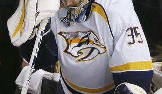 Nashville Predators goalie Pekka Rinne reacts to an empty-net goal by the Pittsburgh Penguins during the third period in Game 1 of the NHL hockey Stanley Cup Finals, Monday, May 29, 2017, in Pittsburgh. (AP Photo/Gene J. Puskar)