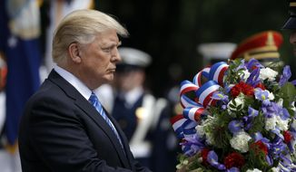 President Donald Trump lays a wreath at The Tomb of the Unknown Solider at Arlington National Cemetery, Monday, May 29, 2017, in Arlington, Va. (AP Photo/Evan Vucci)