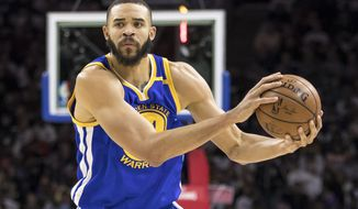 FILE - In this Feb. 27, 2017, file photo, Golden State Warriors' JaVale McGee plays during the first half of an NBA basketball game against the Philadelphia 76ers in Philadelphia. McGee will never call himself a journeyman in describing his rugged professional path. Yet McGee must not look far to find an example of someone else who has learned to thrive as a well-traveled NBA role player: just a quick glance a couple of lockers down to where Shaun Livingston dresses each night at Oracle Arena. (AP Photo/Chris Szagola, File)