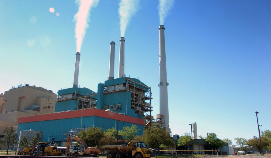President Trump has ordered the dismantling of former President Barack Obama's Clean Power Plan that would regulate carbon emissions in U.S. power plants. (Associated Press) ** FILE **