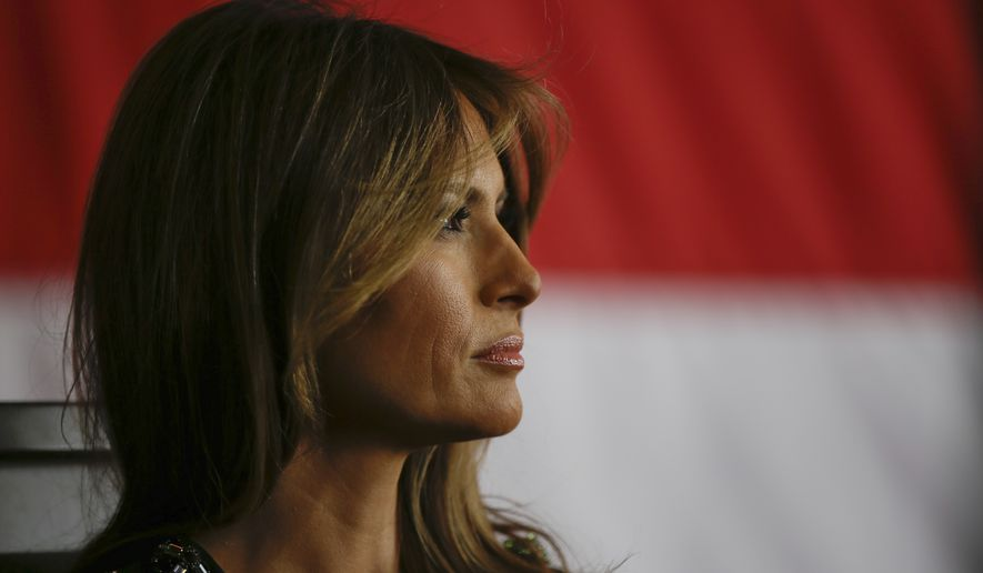 First Lady Melania Trump sits as President Donald Trump addresses U.S. military troops and their families at the Sigonella Naval Air Station, in Sigonella, Italy, Saturday, May 27, 2017. (AP Photo/Luca Bruno)