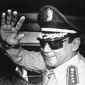 In this Aug. 31, 1989, file photo, Gen. Manuel Antonio Noriega waves to newsmen after a state council meeting, at the presidential palace in Panama City, where they announced the new president of the republic. Panama's ex-dictator Noriega died Monday, May 29, 2017, in a hospital in Panama City. He was 83. (AP Photo/Matias Recart, File)
